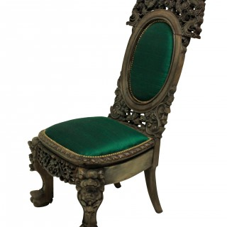 A XIX CENTURY CHINESE CHAIR IN EMERALD SILK