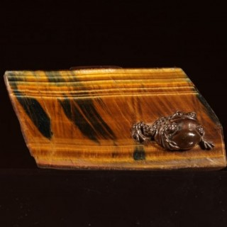 A Japanese Tiger's Eye And Bronze Paperweight.