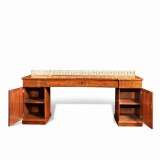 A Regency pale mahogany pedestal sideboard