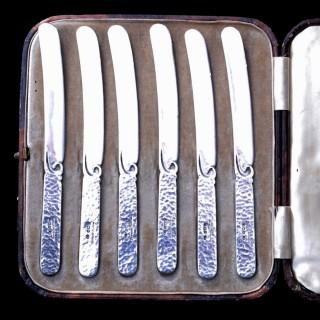 A set of six Bernard Instone silver and enamel boxed knives