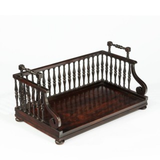 A Regency rosewood book tray attributed to Gillows