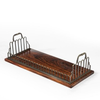 A Regency gilt brass and rosewood book tray, attributed to Gillows