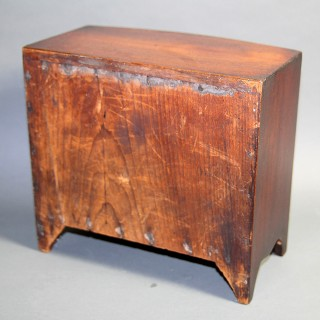 A GEORGE III MAHOGANY MINIATURE BOW FRONTED CHEST OF DRAWERS CIRCA 1800 – 1820