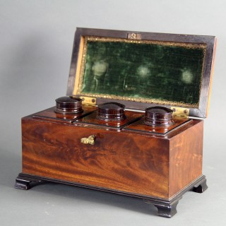 A GEORGE III MAHOGANY TEA CADDY