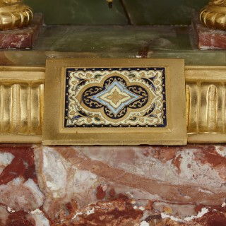 French Renaissance style gilt bronze and enamel mounted onyx standing clock