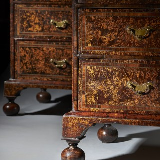 A Pair of Coxed and Woster Mulberry Cabinets on Secretaire Chests
