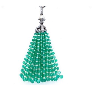 A beautiful tassel pendant with 28 strands of natural pearls and emerald beads suspended from a platinum , diamond and pearl cap