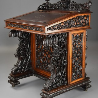 Exquisite mid 19thc Anglo Indian padouk & satinwood profusely carved freestanding davenport of large scale