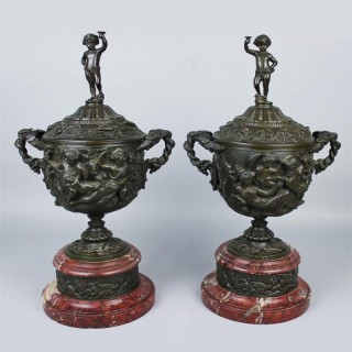 A Fine Pair of Patinated Bronze and Rouge Griotte Marble Urns and Covers