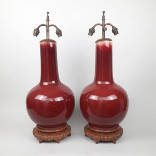 A pair of Chinese Sang de Boeuf vases converted into lamps