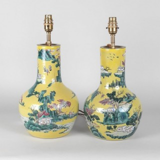 A pair of bright yellow Chinese vase lamps