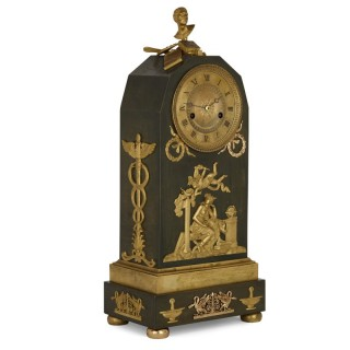 Empire period ormolu mounted bronze allegorical mantel clock