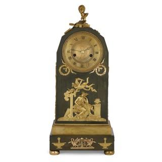 Empire period ormolu mounted bronze allegorical mantel clock