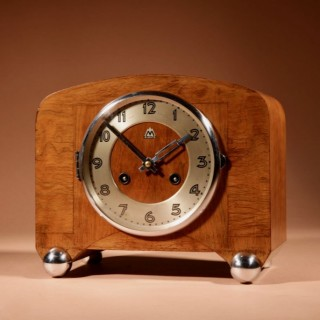 An Art Deco Black Forest Very stylish Walnut Mantel Clock. Circa 1940