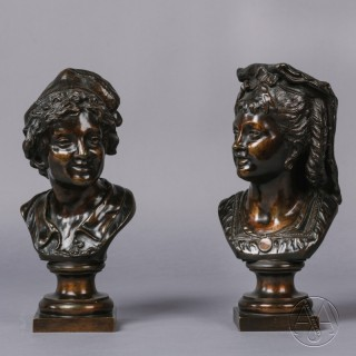 A Pair of Patinated Bronze Busts.