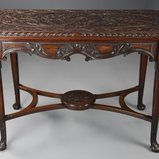 An 18th/19th century finely carved mahogany centre table with later reconfigurements
