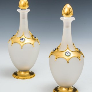 AN EXCEPTIONAL PAIR OF OPAQUE GLASS ORMOLU MOUNTED DECANTERS BY LEUCHARS