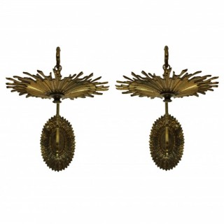 A PAIR OF FRENCH GILT BRONZE SUNBURST BRACKET WALL SCONCES