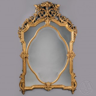 A Fine Louis XVI Style Carved Giltwood and Gesso Mirror
