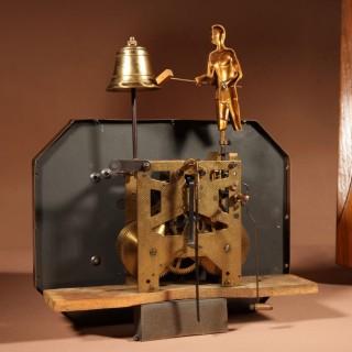 A French Oak Signed Odo Automaton Striking Wall Clock.