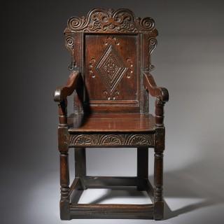 A superb and original carved  Oak Wainscot Armchair, circa 1660. Yorkshire