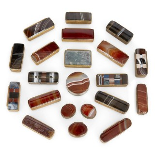 Twenty-one miniature agate boxes mounted with gilt metal