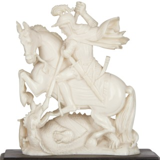 Antique carved ivory sculpture of George battling the Dragon