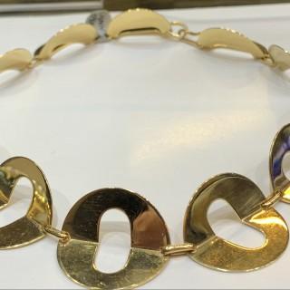 An 18 carat gold collar designed as a ruff in 18 carat gold