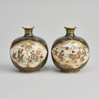A decorative miniature pair of Satsuma vases signed Ryozan