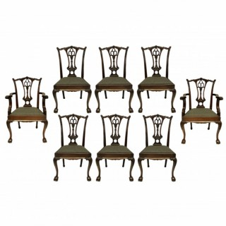 A SET OF EIGHT ENGLISH CHIPPENDALE STYLE DINING CHAIRS