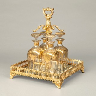 An Antique Crystal Glass and Ormolu Decanter Set