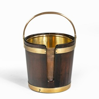 A George III mahogany and brass-bound plate bucket