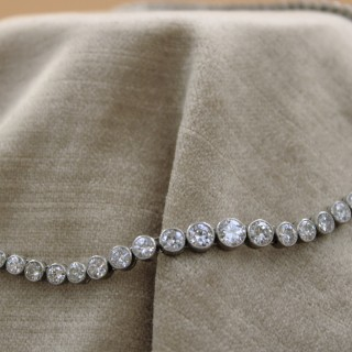 A very fine Diamond Riviere Necklace mounted in Platinum, Circa 1945