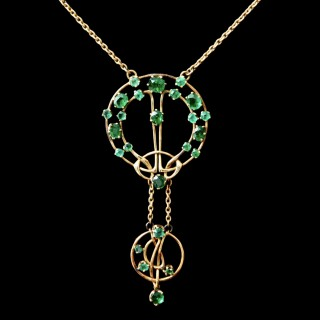 An Archibald Knox for Liberty gold and emerald pendant