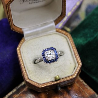 A very fine 0.85ct Diamond & Sapphire Target Ring mounted in Platinum, English, Circa 1920-1930