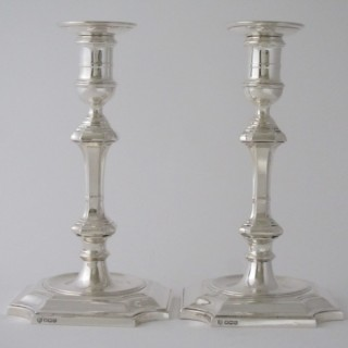 A pair of Antique George V Sterling silver candlesticks