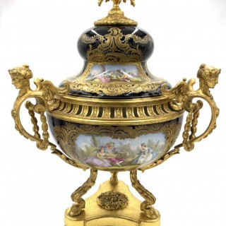 A Sevres-style porcelain blue-ground and gilt-metal mounted three-handled pot pourri urn and cover