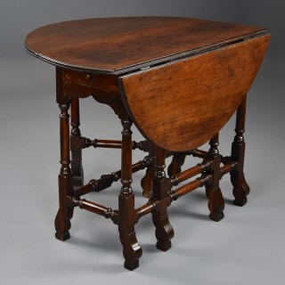 Rare 18th century red walnut gateleg table of small proportions & fine patina