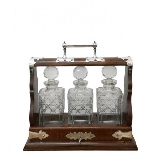 EARLY 20TH CENTURY OAK AND SILVER PLATE TANTALUS