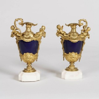 A Pair of Gilt Bronze and Porcelain Vases