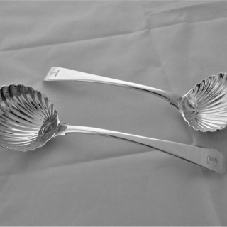 Good matched pair crested George III silver shell bowled ladles