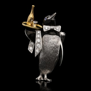 A Charming Platinum, Diamond and Enamel Penguin Waiter Brooch by Wolfe c.1990s