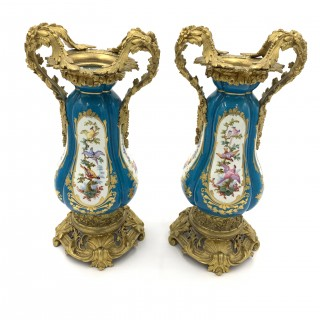 Pair of sky blue ormolu and sevres style porcelain vases
