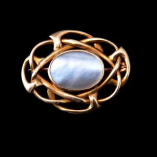 A Liberty gold and mother of pearl Cymric brooch by Archibald Knox
