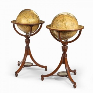 A pair of 12-inch floor globes by Cary