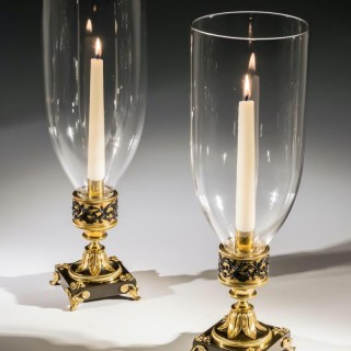 A GILT BRONZE PAIR OF REGENCY STORM LIGHTS