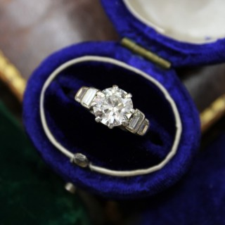 A very fine Platinum (marked)  1.16ct Diamond Solitaire Ring with Stepped Shoulders, English, c. 1945