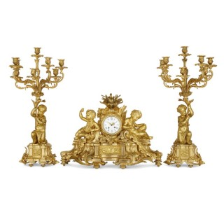 Gilt bronze three-piece clock set by Raingo Frères and Henri Picard
