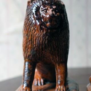 A Pair of Edwardian Period Naïve Treacle-Glazed Pottery Lions c.1905