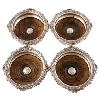 Four Sheffield Plate Wine Coasters